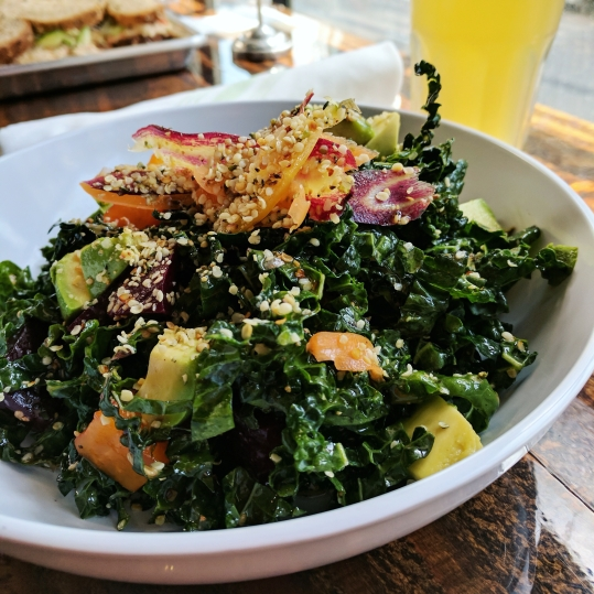 A delicious kale salad with kombucha